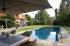 Overloopzwembad met ronde trap bekleed met mozaïek