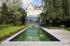 Zwemvijver met strakke vorm aangelegd door Tuinteam, Demooistezwembaden.be