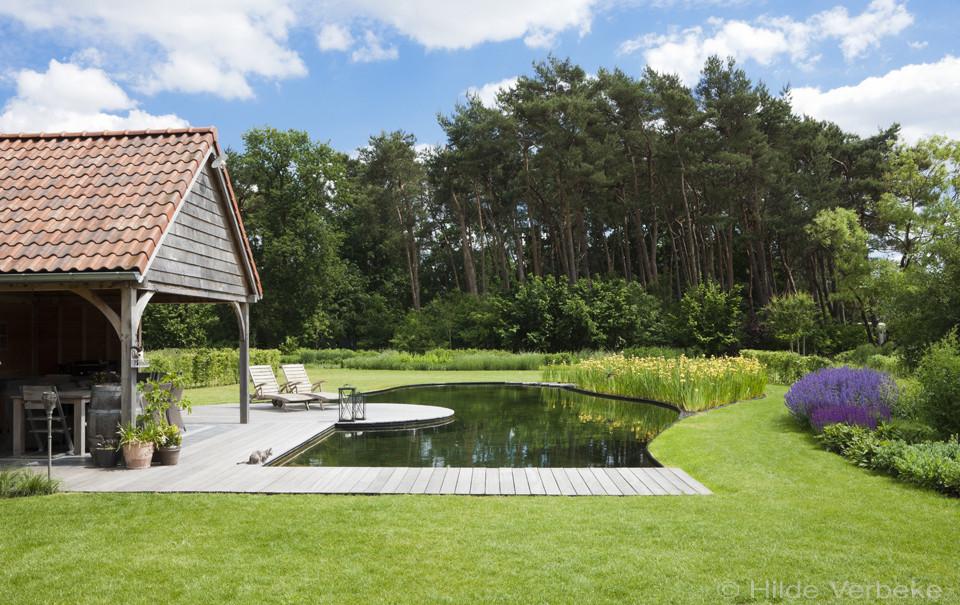 Natuurlijke zwemvijver passend in het landschap u de mooiste zwembaden