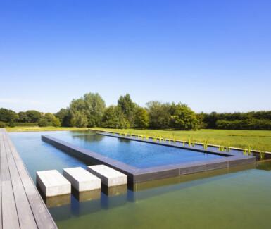 combinatie zwemvijver en infinity pool aangelegd door my pool, Hugelier zwembaden